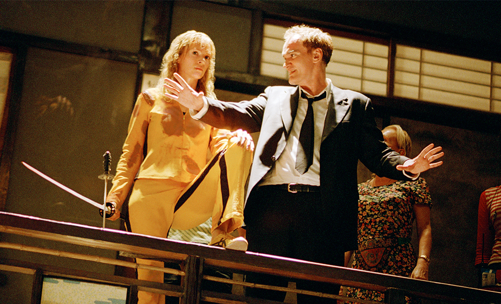 "Uma Thurman and director Quentin Tarantino on the set of ""Kill Bill: Vol. 1"""